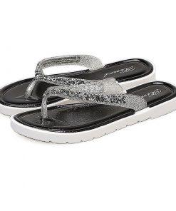 Sandalias planas diseño pata de gallo con pedrería brillante
