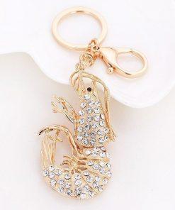 Llavero en forma de langosta con diamantes de imitación